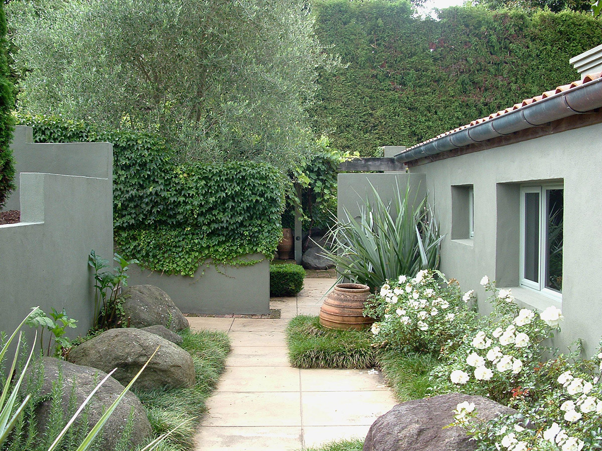 landscaped courtyard entrance with pathway